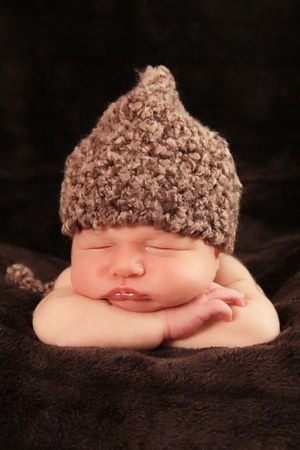 Newborn baby boy asleep on a blanket. Stock Photo