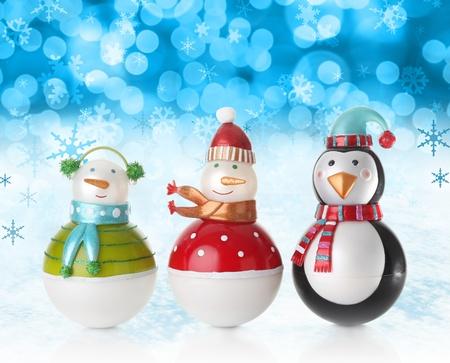 christmas backgrounds: Snowmen on a festive Christmas snow background.
