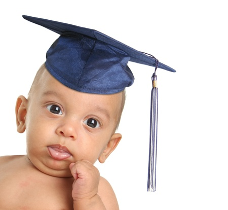 Three month old baby boy wearing a graduation mortar board. Stock Photo - 10905525