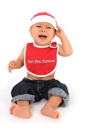 Santa baby boy crying.  Stock Photo - 10905528