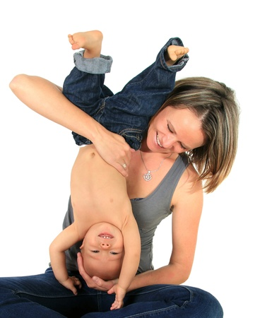 Happy mom and one year old baby boy playful together.  Stock Photo - 10930507