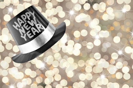 Happy new year top hat with a festive glitter background.