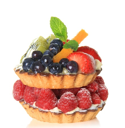 Fresh fruit pie tarts stacked on top of each other.   photo
