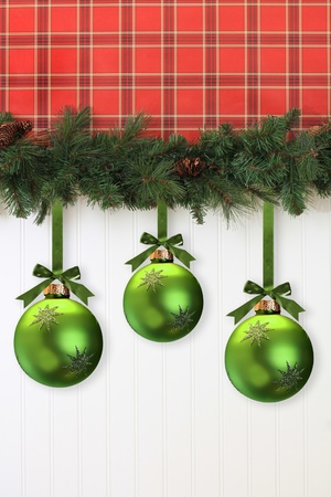 Christmas garland and ornaments, hanging on the wall. photo