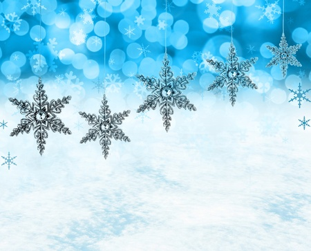 Festive Christmas snow flakes background, includes real snow in the bottom half of the image.