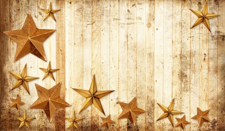 country western: Christmas stars on a weathered country wooden background.  Stock Photo