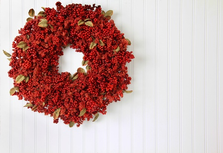 Country red berry Christmas wreath. photo