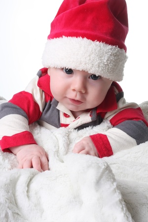 Baby boy in a Christmas Santa hat.  photo