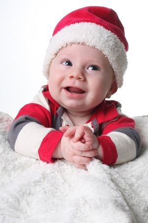 Happy baby in a Christmas Santa hat. photo