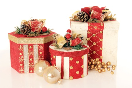 three presents: Beautifully wrapped Christmas gifts, isolated on white.