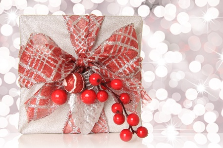 Beautifully wrapped Christmas gift, isolated on white.