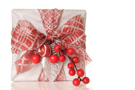 Beautifully wrapped Christmas gift, isolated on white.  photo