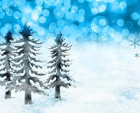 Festive Christmas trees and snow scene photo