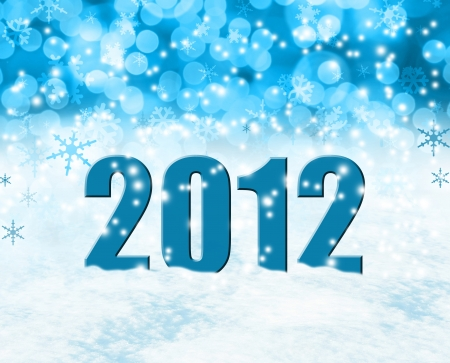 Happy new year 2012 on snowy background.  photo