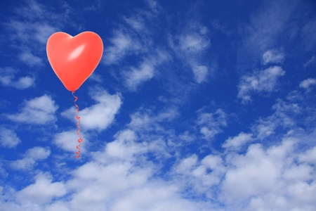 Valentine heart balloon floating in the sky.  photo