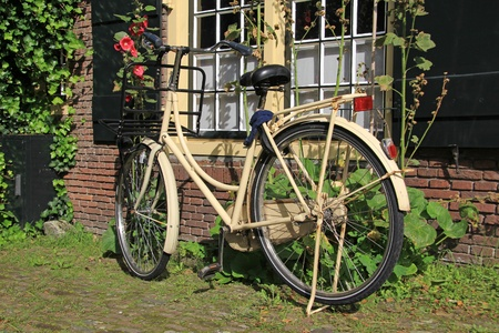 Ladies city bike parked in a charming Dutch courtyard.  photo