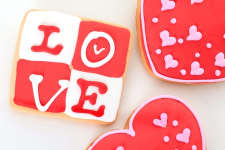 Valentine love cookie in red and white. photo