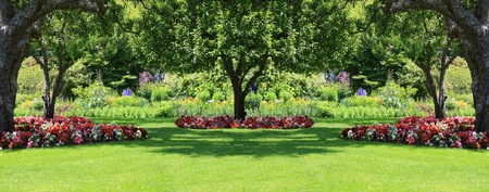 shade: Beautifully manicured park garden in summer.