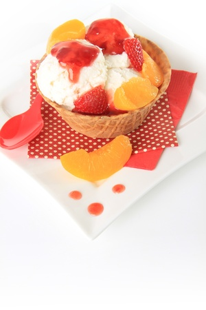 Vanilla Ice cream sundae with strawberry and peach   photo