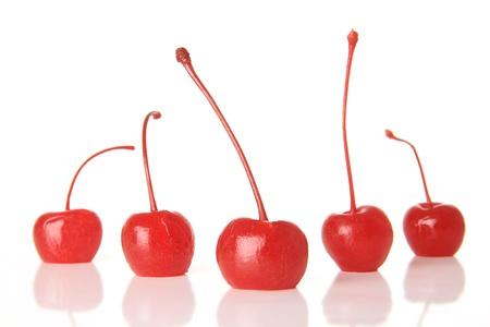 Red maraschino cherries, studio isolated