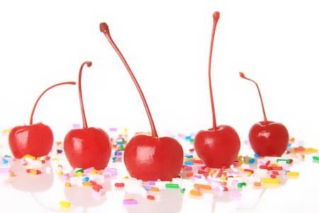 maraschino: Red maraschino cherries and birthday sprinkles   Stock Photo