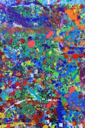 splatter paint: Paint splattered wall in an art studio Stock Photo