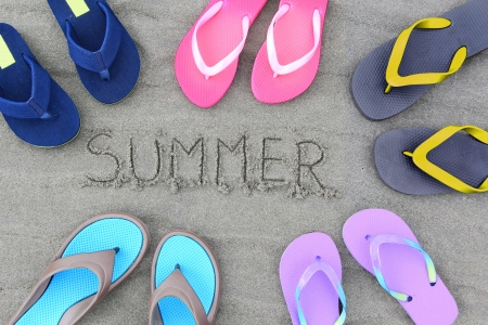 Summer flip flops on the beach Reklamní fotografie - 14299376
