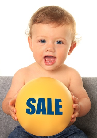 Adorable ten month old baby boy holding a yellow ball with a sale sign  Also available without text, add your own   photo