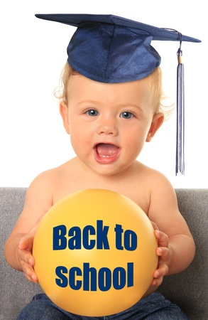 early education: Baby with mortar board  Add your own text on the yellow ball   Stock Photo