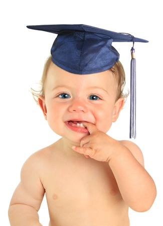 Adorable ten month old baby boy wearing a mortar board. photo