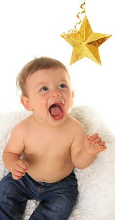 room for text: Ten month old boy laughing and reaching for a star.