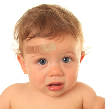wound care: Baby boy with bandaid.