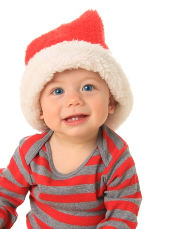 Adorable ten month old baby boy wearing a Santa hat. Stock Photo - 15256012