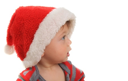 Ten month old baby boy wearing a Santa hat and looking at copy space Stock Photo - 15291480