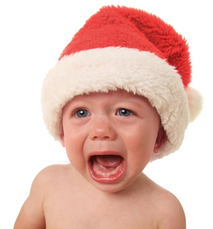 children sad: Crying Santa baby boy, 10 months old
