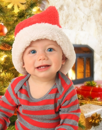 Adorable ten month old baby boy wearing a Santa hat Stock Photo - 15435494
