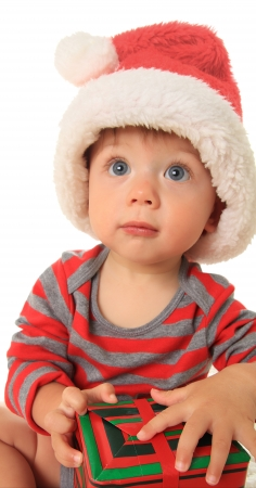 Adorable ten month old baby boy wearing a Santa hat Stock Photo - 15435432