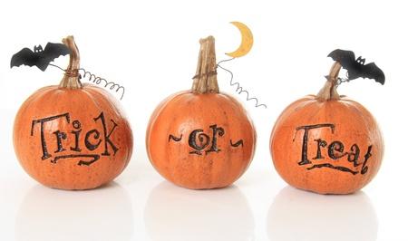 Three small trick or treat pumpkins Stock Photo - 15422510