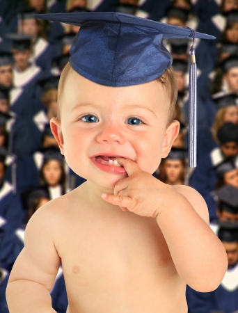Adorable ten month old baby boy wearing a mortar board in front of a class of graduates   photo