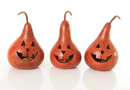Three cute happy jack o lantern pumpkins.  Stock Photo - 15630642