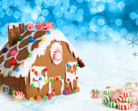 Gingerbread house on a festive Christmas snow background  photo