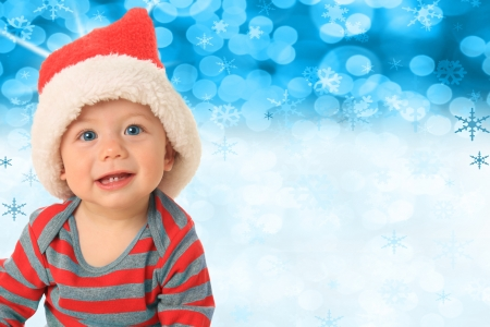 Santa baby in front of a blue Christmas background   Stock Photo - 16085476