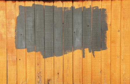Old fence with a fresh paint patch Stock Photo - 16148670