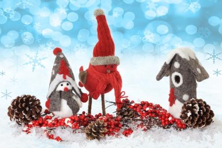 Christmas winter bird ornaments in snow Stock Photo - 16295581