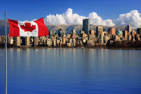 Canadian flag in front of the beautiful city of Vancouver, Canada  Stok Fotoğraf