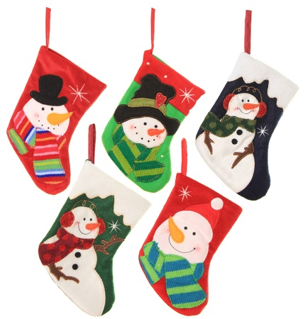 Five friendly snowman Christmas stockings, studio isolated on white   photo