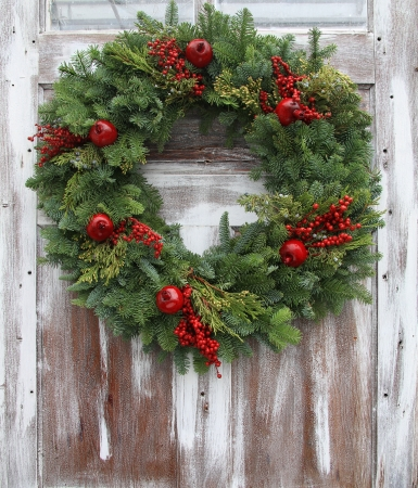 wreath: Christmas wreath on a rustic wooden front door
