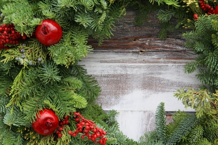 Christmas garland on a rustic wooden background. Archivio Fotografico