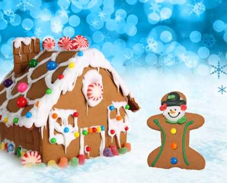 Gingerbread house and man on a festive Christmas snow background  photo