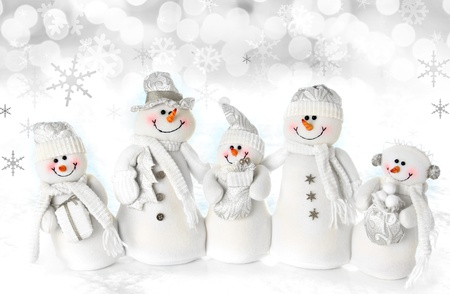Friendly Christmas snowman family on a snow background   Stock Photo - 16587304